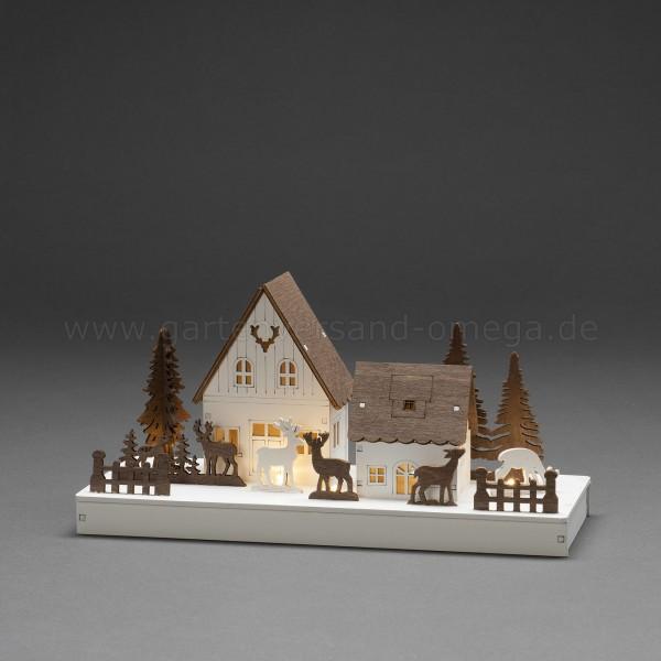 LED-Holzsilhouette Waldhäuser mit Rentieren